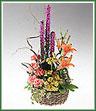 Basket arrangement of bright flowers