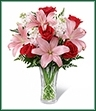 The Anniversary Bouquet is a gorgeous way to celebrate your sweet affection for the love of your life on your special day. Showcasing rich red roses, brilliant pink Asiatic lilies, pale pink stock and a variety of lush greens, this beautiful bouquet is presented in a clear t glass vase for a classic look of sophistication and elegance.