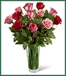 The True Romance Rose Bouquet is the perfect expression of love and passion. A bright burst of color, this bouquet combines red, pink and fuchsia roses, accented with beautiful greens and seated in a clear glass vase, to create a truly romantic representation of your love.