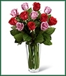 The Red and Lavender Rose Bouquet beautifully expresses your love with its gorgeous combination of color and elegance. Rich red roses mingle with lavender roses accented with vibrant greens, all arranged in a clear glass vase to make a lasting impression on your sweetheart this Valentine's Day.