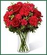The Always True Bouquet blossoms with love's tender message. Rich red roses and carnations are accented with fuchsia mini carnations and lush greens arranged to perfection in a classic clear glass vase to create an exceptional way to convey your heart's most intimate wishes.