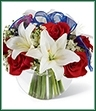 The Independence Bouquet will dazzle your recipient this Summer just in time for the exciting celebration that the Fourth of July brings. Brilliant red roses and white Asiatic lilies are subtly accented with Queen Anne's Lace and a sheer blue ribbon all perfectly presented in a clear glass bubble bowl creating a gorgeous gift that will make their holiday complete.