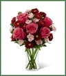 The Precious Heart Bouquet is a blushing display of loving kindness. Fuchsia roses are sweetly stunning amongst red matsumoto asters, pink mini carnations and lush greens. Arranged in a classic clear glass vase, this bouquet boasts pink perfection to convey your warmest wishes.
