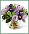 The Splendid Day Bouquet, set with roses and asters, creates the perfect bouquet for any of life's special moments. Lavender roses, lavender monte casino asters, purple matsumoto asters, green hypericum berries, green button poms and lush greens create a stunning flower bouquet perfectly arranged in a clear glass bubble bowl vase to create a wonderful thank you, happy birthday or congratulations gift.