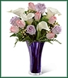 The Beautiful Expressions Bouquet, blooming with tulips, roses and calla lilies, is an exquisite flower bouquet set to impress. Pale pink tulips, lavender roses, white open-cut calla lilies, peach hypericum berries and lush greens are beautifully arranged in a violet flared glass vase to create a wonderful way to convey your sweetest emotions on your anniversary, for their birthday or just to brighten their day.