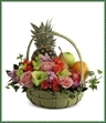 The Fruit & Flowers Basket is a thoughtful gift that conveys your warmest sentiments. Pink roses, pink stock, orange spray roses, green gladiolus, variegated ivy, and lush greens are arranged amongst a collection of fruit, gorgeously seated in a large green basket to create a stunning gift.
