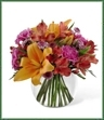 The Light of My Life Bouquet offers your special recipient fresh vibrant color to brighten their day! Orange Asiatic lilies, fuchsia carnations, red Peruvian lilies, lavender chrysanthemums and lush greens are perfectly arranged in a clear glass bubble bowl vase to send your sweetest sentiments across the miles.