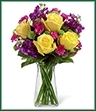 The Happy Times Bouquet employs roses and stock to bring vibrant color and fragrance straight to their door on their special day. Yellow roses, purple stock, green button poms, fuchsia mini carnations and lush greens create a stunning display beautifully arranged in a clear gathered square glass vase to help you convey your happy birthday wishes or send your congratulations.