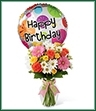 The Birthday Cheer Bouquet is set to celebrate with its bright, beautiful blooms wishing your special recipient every happiness on their big day! Coral roses, yellow spray roses, hot pink gerbera daisies, white traditional daisies, solidago and lush greens are perfectly arranged in a classic clear glass vase tied with pink satin and green chenille ribbons. Arriving with a mylar balloon exclaiming,