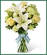The Boy-Oh-Boy Bouquet employs roses and Asiatic lilies to send your bright and sunny congratulations on the birth of their new baby boy! Yellow roses and carnations are brought together with pale green mini carnations, white Asiatic lilies, yellow solidago and lush greens exquisitely arranged in a clear glass gathered square vase. Accented with blue and lavender wired ribbon, this bouquet creates a wonderful way to send your warmest wishes for the adventure of parenthood ahead.