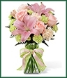 The Girl Power Bouquet brings together roses and Asiatic lilies to send your sweetest sentiments and offer your congratulations on the birth of their new baby girl! Pink roses, pink Asiatic lilies, pale peach carnations, pale green mini carnations and lush greens are exquisitely arranged in a clear glass gathered square vase. Accented with a pink satin ribbon, this flower bouquet creates a wonderful way to send your warmest wishes for the adventure of parenthood ahead.