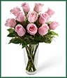 Picture-perfect soft pink roses make a beautiful gift for the lovely lady in your life. Wife, mother, daughter or sweetheart, she's sure to cherish this bouquet of pastel pink roses accented with seeded eucalyptus and arranged in a clear glass vase.
