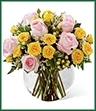 The Soft Serenade Rose Bouquet is a sunny and charming flower arrangement set to spread your warmest wishes. Pink roses, yellow spray roses, white hypericum berries, white limonium and lush greens are perfectly arranged within a clear glass bubble bowl vase to create a wonderful way to say thank you, get well or to extend your congratulations.