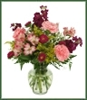 Tenderness, beauty and elegance is offered with this assortment of pink alstromeria and carnations, fuchsia stock, matsumoto asters, yellow solidago and baby's breath arranged in a clear glass vase. Appropriate for any occasion including Birthday, Anniversary, Get Well.