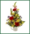 A mug of snapdragons,  daisy spray mums, carnations and asters. Color of mug may vary.