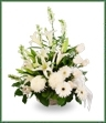 A garden basket  in all white of lilies,  roses, gerbera and snapdragons.