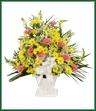 A mache arrangement of traditional flowers including daisy spray mums, snapdragons and carnations.