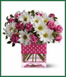 Polka dots and posies, they're the perfect pair. Well, at least in this pretty arrangement they are. Just the right flowers in just the right vase all wrapped up in… you guessed it, just the right ribbon. Pink spray roses and white daisy spray chrysanthemums are delivered in an exclusive pink vase that's wrapped with a polka-dot satin ribbon.