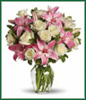 A romantic gift like this one is always appreciated. An eye-catching display of roses and lilies is perfectly arranged in a feminine vase which makes a beautiful and lasting impression. Elegant white roses and sweet pink asiatic lilies are hand-arranged with greens. It's the perfect way to show you love her always and forever.